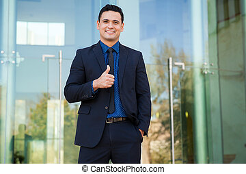Sign of approval - Attractive young businessman giving a...