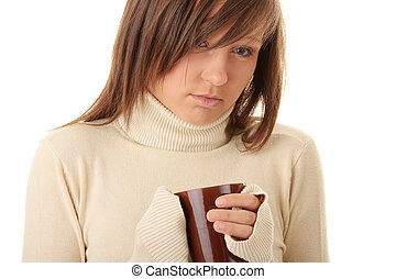 A beautiful girl holding a cup of hot drink - A beautiful...
