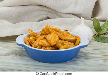 Crouton in the bowl on wooden background