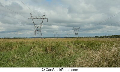 Electrical pylons in field - Electrical pylons in a summer...