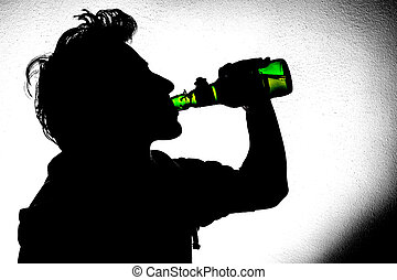 Young man drinking beer - Silhouette of a young man drinking...