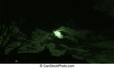 Clouds moving beneath full moon - Timelapse at night with...