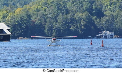 Seaplane taxiing on the lake. Steady shot on tripod. Zoom...