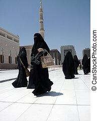 Women in Burka walking - Women walking past the Prophet\'s...