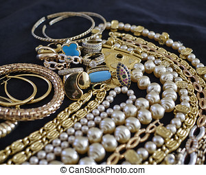 variety of precious jewelry closeup, strong bokeh - pirate's...