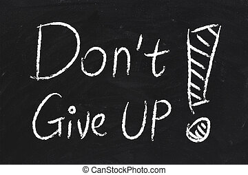 Do Not Give Up text is written by chalk on blackboard