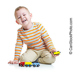 Kid boy playing with train toy on white background