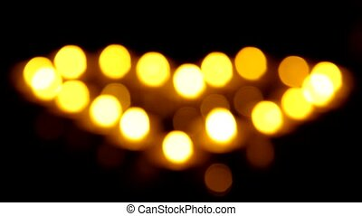 Heart shape made of candles - Unfocused heart shape from...