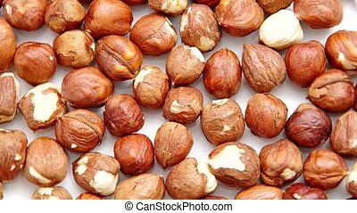 Hazelnuts are spinning on a table