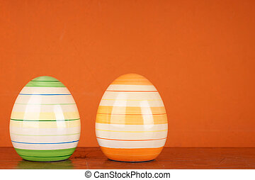 Happy Easter - Two modern ceramic easter eggs in front of...