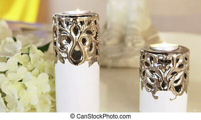 Burning candles on background color - On table wedding...