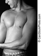 Sporty bare-chested man in B&W