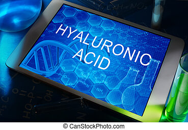 Hyaluronic acid - the words Hyaluronic acid on a tablet with...