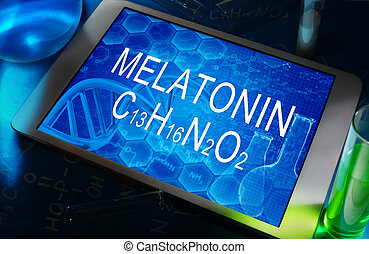 melatonin - the chemical formula of melatonin on a tablet...
