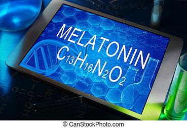 melatonin - the chemical formula of melatonin on a tablet...
