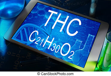 THC - the chemical formula of THC on a tablet with test...