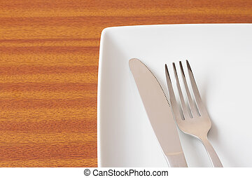 White place setting on wooden table