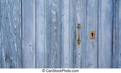 Old blue run-down wooden door and lock - Closeup of blue...