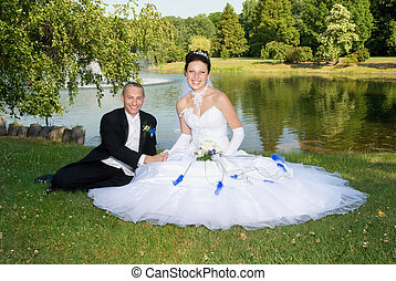 Love and Marriage - Beautiful bride with groom at the park...