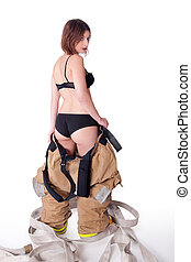 Sexy Female Firefighter in fire gear and bra