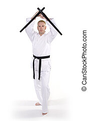 Martial Arts - First Degree Black Belt with tonfa.