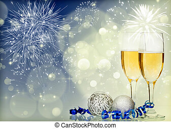 Glasses with champagne and Christmas decoration on sparkling...