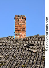 Old roof with brick chimney