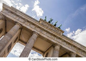 brandenburger tor in berlin with blue cloudy sky