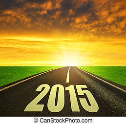 Forward to the New Year 2015 - Asphalted road at sunset...