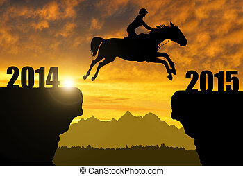 The rider on the horse jumping into the New Year 2015