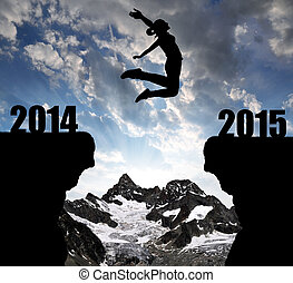 Girl jumps to the New Year 2015 in the background mount Ober...