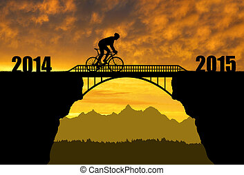Forward to the New Year 2015 - Cyclist riding across the...