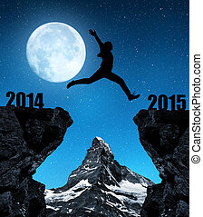 Girl jumps to the New Year 2015 in the background mount...