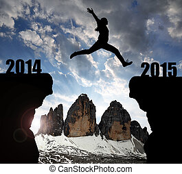 Girl jumps to the New Year 2015 in the background Tre cime...