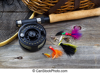 Fishing Gear on Rustic Wood - Close up top view of fishing...