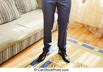Legs of business man in pants