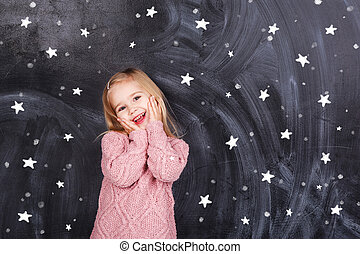 The girl on the background of stars - Thoughts of children...