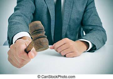 man about to struck a gavel - closeup of a man in suit about...
