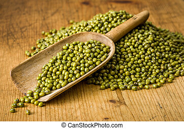 Wooden scoop with mung beans