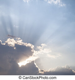 Sun rays through the clouds - Sun rays streaming through the...