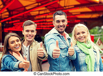 group of smiling friends showing thumbs up - leisure,...
