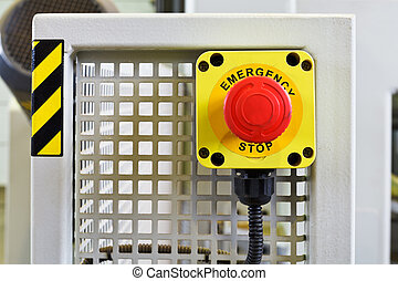 red emergency stop push button on engine close up