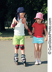 Friendly support. Rollerblading. - little girl helping her...