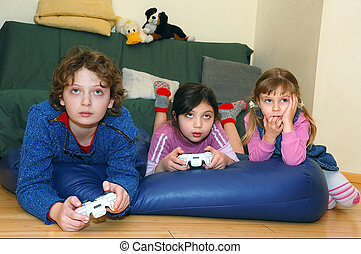 Playing Computer Games - group of kids playing a video game