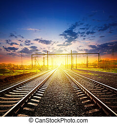 Railway receding into the distance under a sunset sky