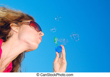 blowing soap bubbles wand