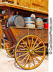 Old cart with wine barrelsWild West