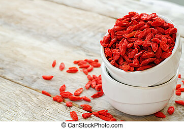 Goji berries on white wood background tinting selective...