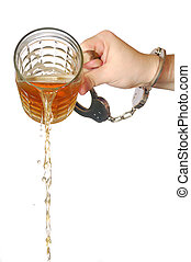 pouring beer away - male hand chained to a mug of beer...