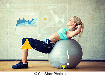 smiling woman with exercise ball in gym - fitness, sport,...